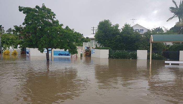 Townsville dentist Courtney Dental with flood waters in Hermit Park